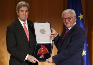 U.S. Secretary of State John Kerry receives the Grand Cross, First Class of the order of Merit of the Federal Republic of Germany from German Foreign Minister Frank-Walter Steinmeier (R) at the Foreign Ministry in Berlin, Germany, December 5, 2016.     REUTERS/Fabrizio Bensch